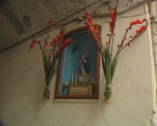 Pan from Virgin Mary statue to quiet passage Stock Footage