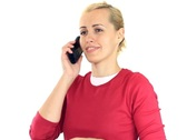 Attractive woman talking on mobile phone, isolated on white NTSC Stock Footage