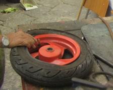 Man fixing vehicle wheel Stock Footage