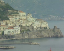 Distant view of coastal buildings and sea Stock Footage