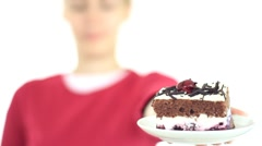 Female hand offering tasty cake, isolated on white HD - stock footage