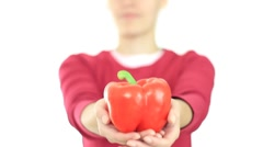 Female hand offering red pepper, isolated on white HD Stock Footage