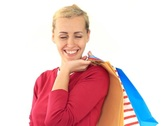 Attractive happy woman holding shopping bags, isolated on white NTSC Stock Footage