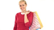 Attractive woman with shopping bags walk in and walk out, isolated on white HD Stock Footage