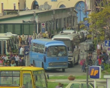 Buses leaving busy depot Stock Footage