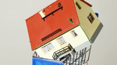 Toy house placed on top of little trolley turning around Stock Footage