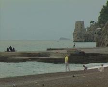 Family on stony beach Stock Footage