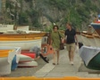 Couple walking between landed boats SD Footage