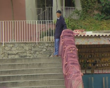 Man standing at top of stairs Stock Footage