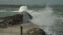 Waves crashing over a water break. Stock Footage