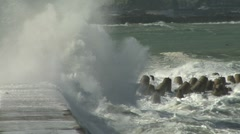 Large waves breaking over a seawall Stock Footage