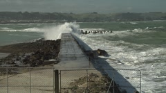 Small waves washing down seawall away from camera - stock footage