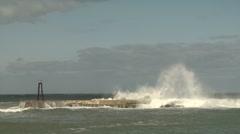 Wave washing down seawall Stock Footage