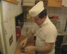 Chef making pizza and putting in oven Stock Footage