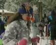 Girl on skis walking past Footage