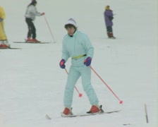 Skier going slowly down slope Stock Footage