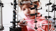 Stock Video Footage of Little girl have fun with space marble run