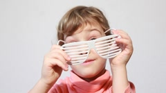 Little girl play with shutter shades glasses Stock Footage