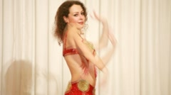 Eastern dancer in red perform bellydance Stock Footage