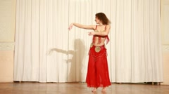 Woman dancing in eastern style in red traditional costume Stock Footage