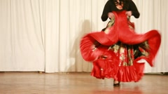Gypsy female in red dress perform traditional dance Stock Footage