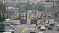 Busy traffic on a road under construction in China - stock footage