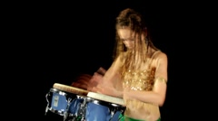 Beautiful female percussion drummer performing with bongos Stock Footage