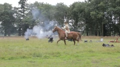 Confederate rider surrounds ambushed Union troops Stock Footage
