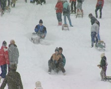 Family riding sled and falling off Stock Footage