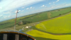 Aircraft, Schweizer glider on board in flight landing on grass strip Stock Footage
