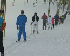 Line of people pulled along on ski lift Stock Footage