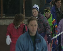 Women getting on ski drag lift Stock Footage