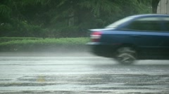 Traffic drives through heavy storm and monsoon rain in China Stock Footage