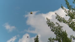 Helicopter, huey with bucket, through frame Stock Footage