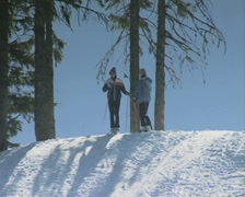 Two skiers standing at top of slope Stock Footage