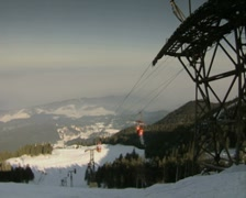 View of mountainside down chair lift Stock Footage