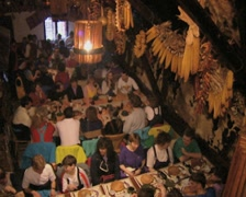People dining together while band plays traditional music Stock Footage