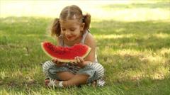 Little girl eat watermelon Stock Footage