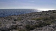 Rocky coast rippling water surface Istria Croatia Stock Footage