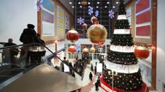 People move near big Christmas tree in shopping mall Golden Babylon Stock Footage