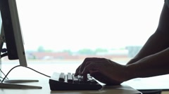 Man at computer terminal typing Stock Footage