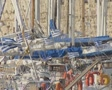 View looking across line of sailing boats in harbour with Greek flags Footage
