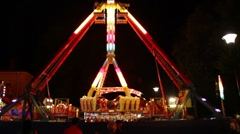 Amusement park ride by night Stock Footage
