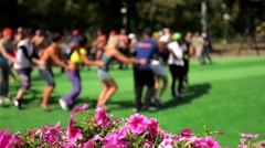 A group of people engaged in fitness outdoors Stock Footage