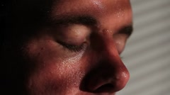 Close up of a nervous, agitated man sweating - stock footage