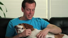 Happy man petting his dog - stock footage