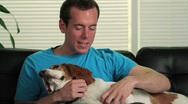 Happy man petting his dog Stock Footage