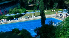 Time-lapse: tourists near hotel pool,  Corfu, Greece Stock Footage