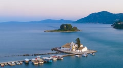 Time-lapse: aerial view of of Vlacherna monastery before sunset, Corfu, Greece Stock Footage