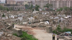 A family walks through an old demolished quarter in China Stock Footage